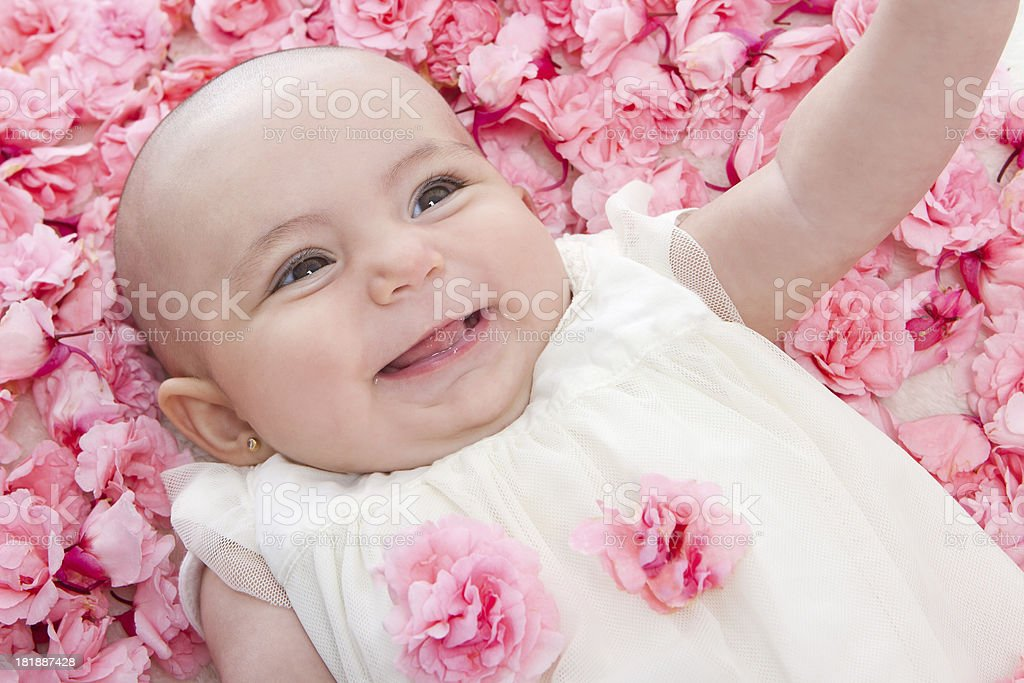Baby with pink flowers royalty-free stock photo