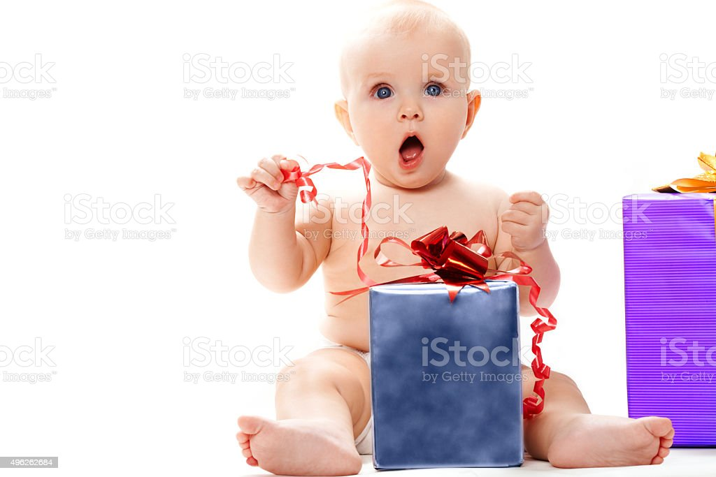 Baby with present stock photo