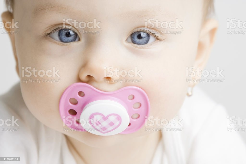 Baby with soother stock photo