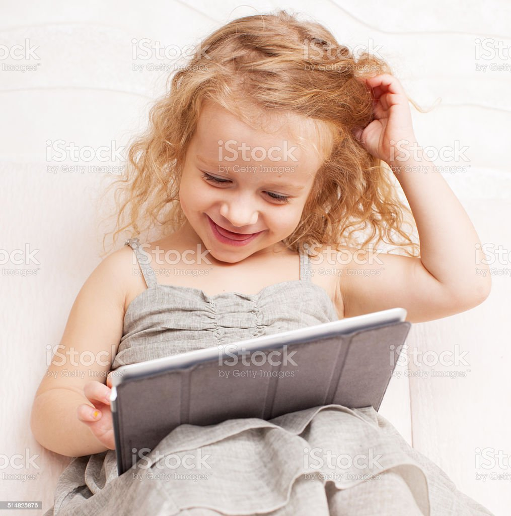 Baby with tablet computer stock photo