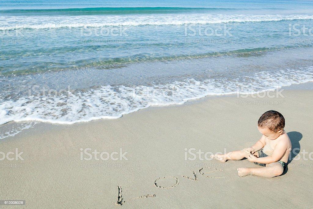 Baby Write Love on the Beach stock photo