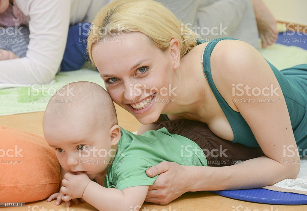 Baby Yoga indoor training with mother stock photo