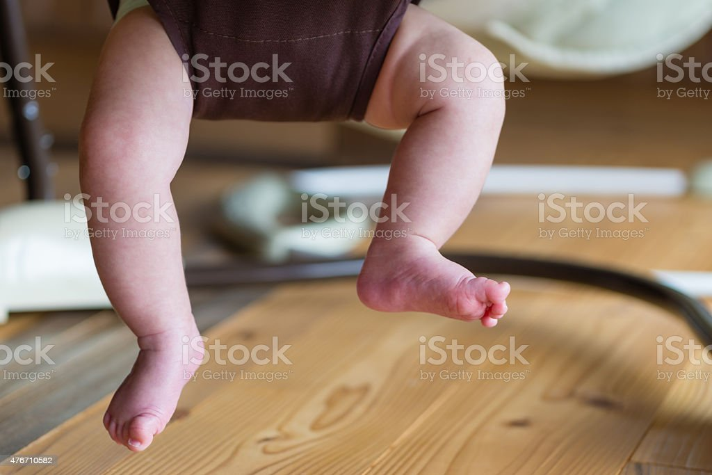 Baby's Bouncing Legs stock photo