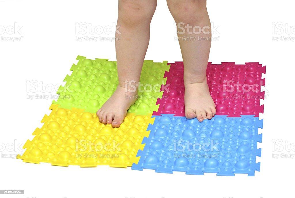 baby's feet on the mat orthopedic stock photo