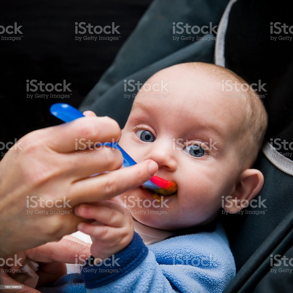 Baby's First Solid Food royalty-free stock photo