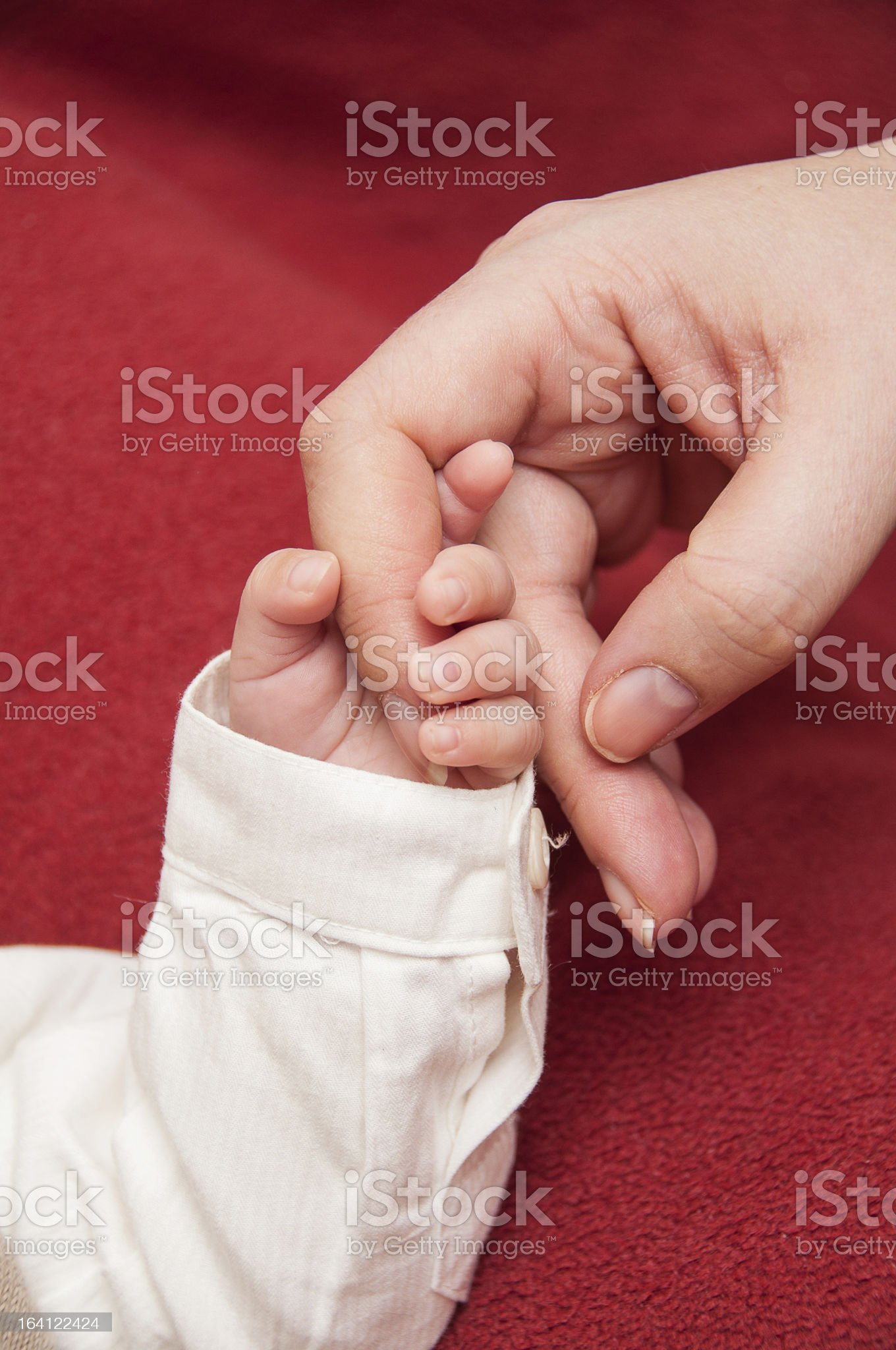 Baby's hand with mama's finger royalty-free stock photo