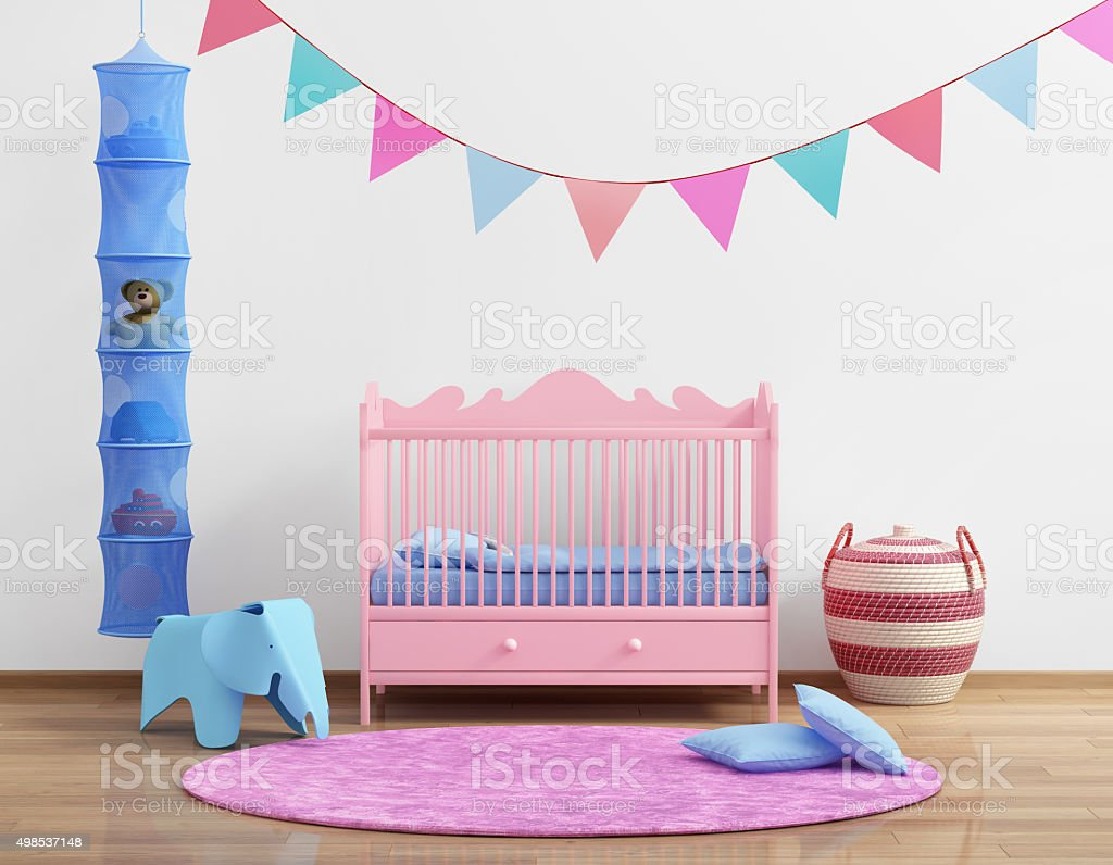 Baby's pink nursery room with flags and rug stock photo