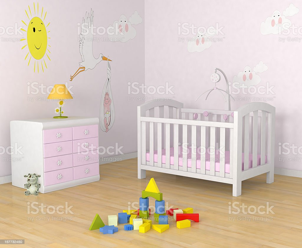 Baby's room with decor, crib, toys and a dresser with lamp stock photo