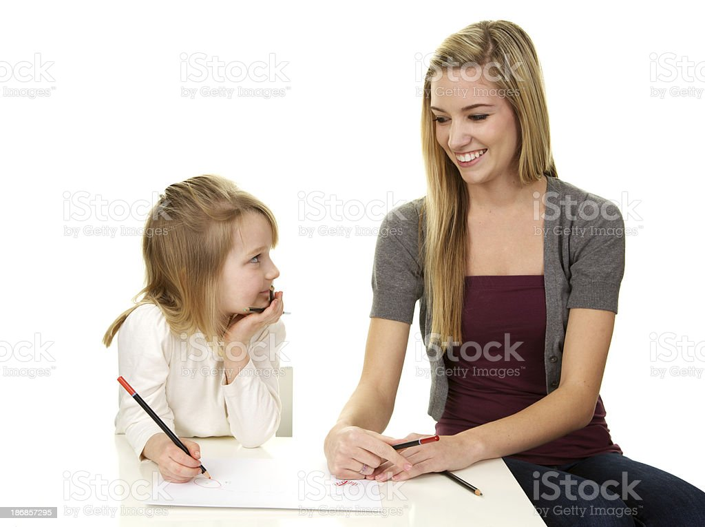 Babysitter Drawing with a Little Girl royalty-free stock photo