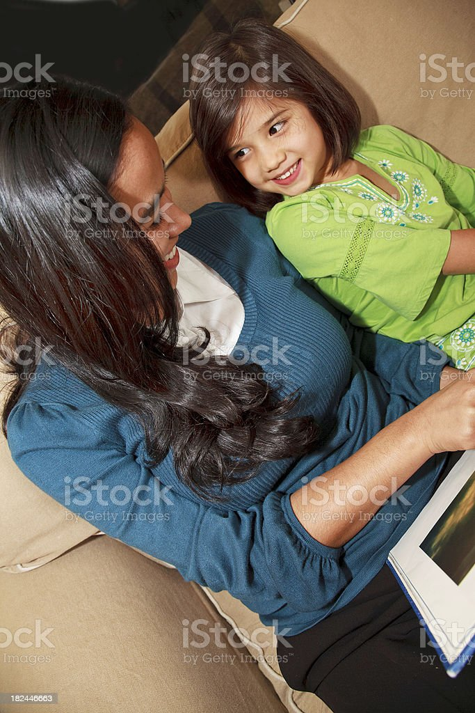 Babysitter reading book to Cute Little Girl royalty-free stock photo