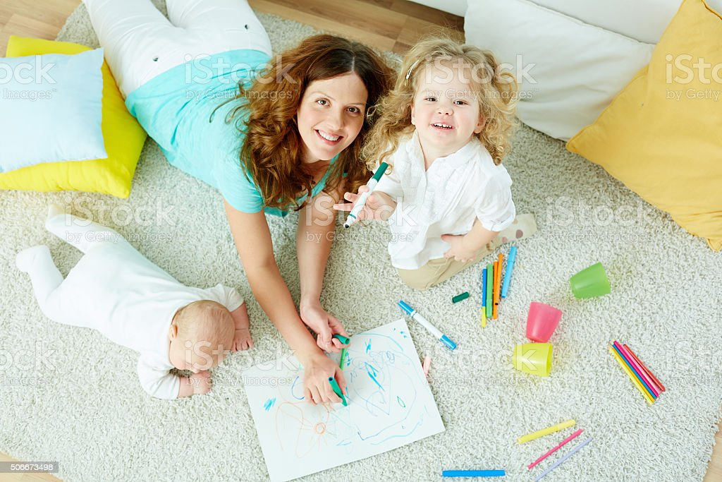 Babysitter with kids stock photo
