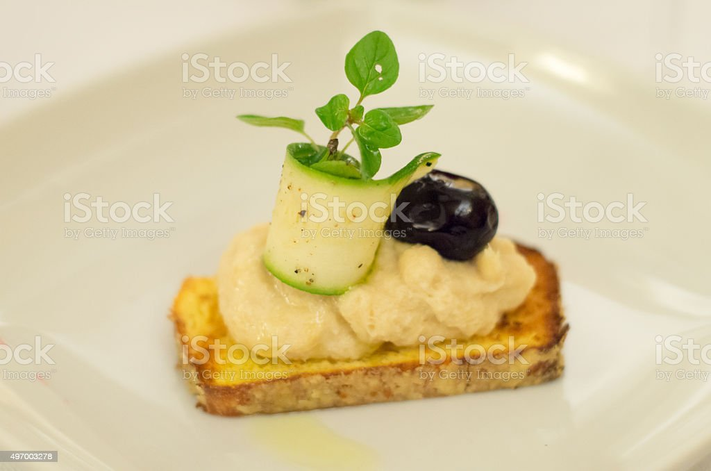 Bruschetta di baccala con oliva stock photo