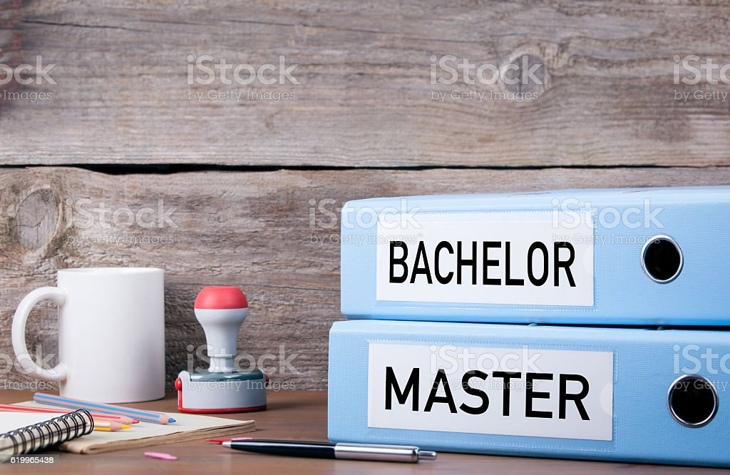 Bachelor and Master. Two binders on desk stock photo