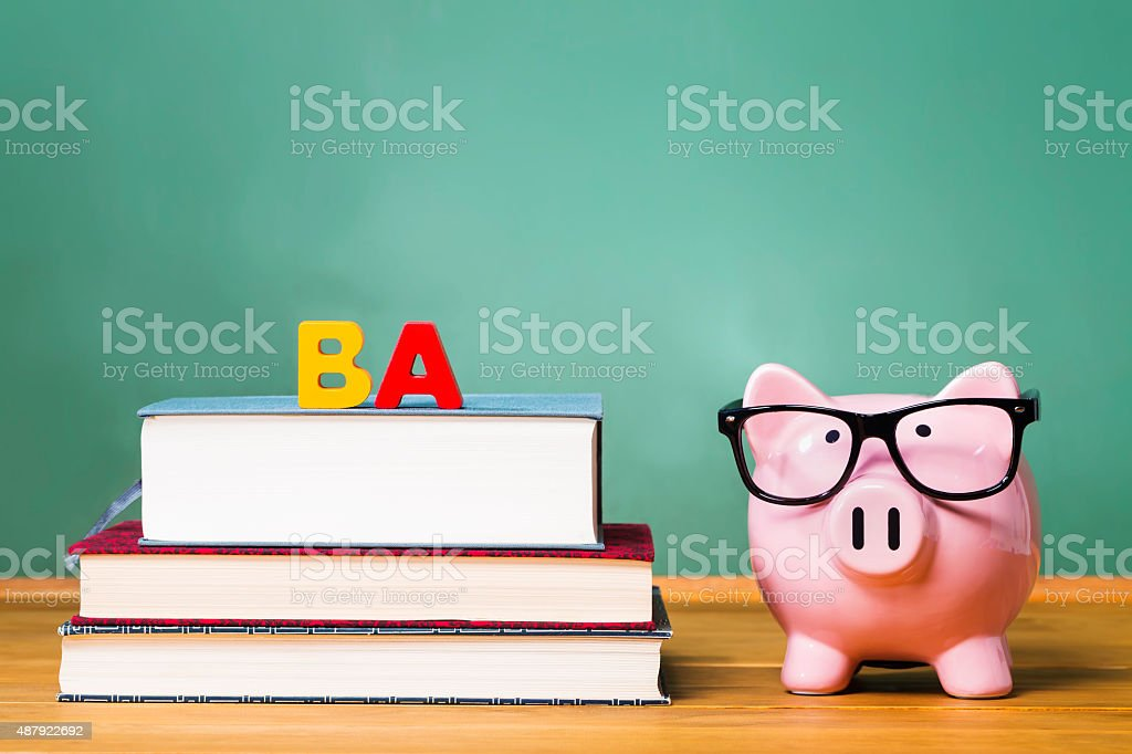 Bachelor of Arts degree theme with textbooks and piggy bank stock photo
