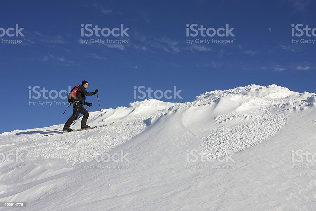 Back country mountain skier on summit royalty-free stock photo