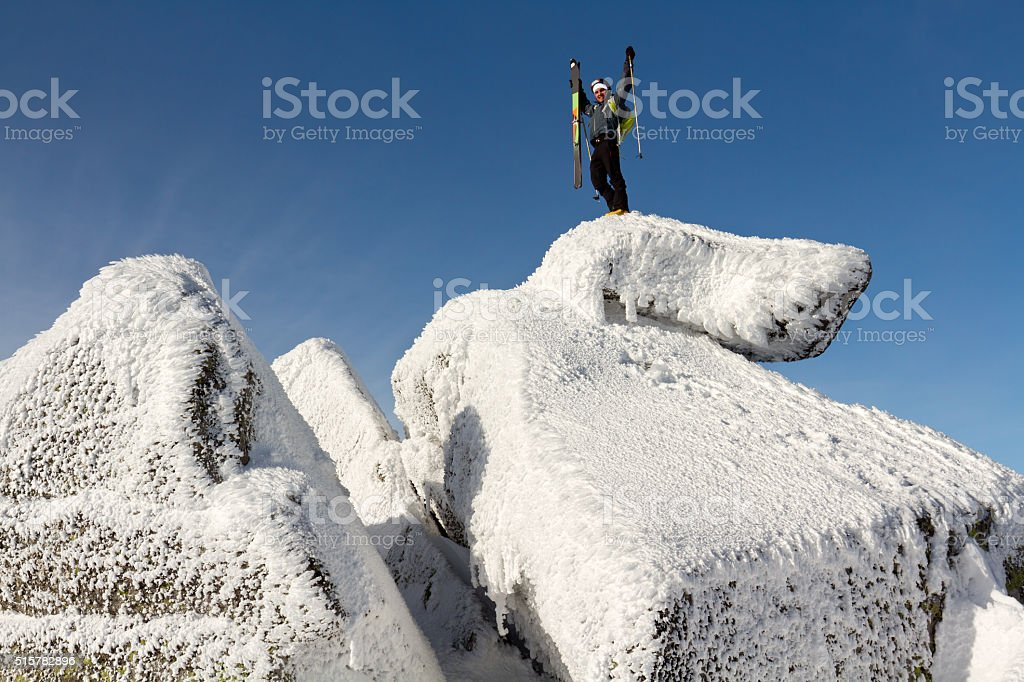 Back country skier making to the top stock photo
