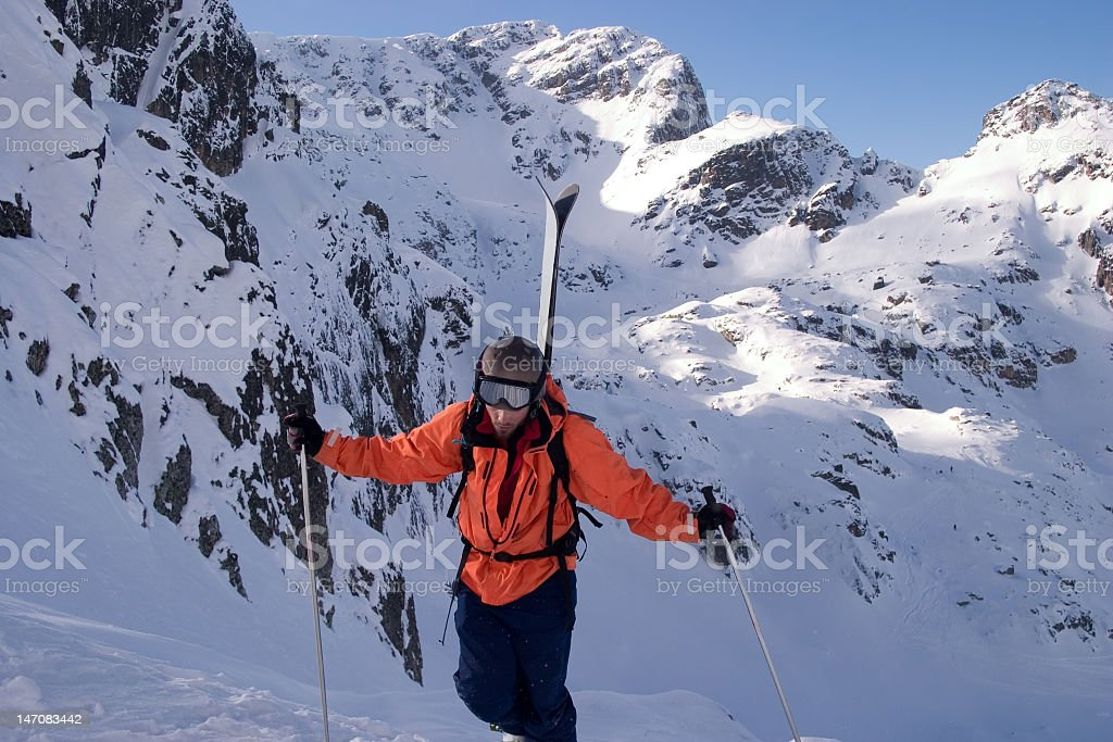 Back country skier on his way to the top royalty-free stock photo