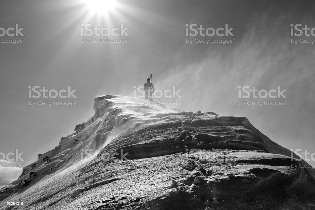 Back country skier reaching the top of the mountain royalty-free stock photo