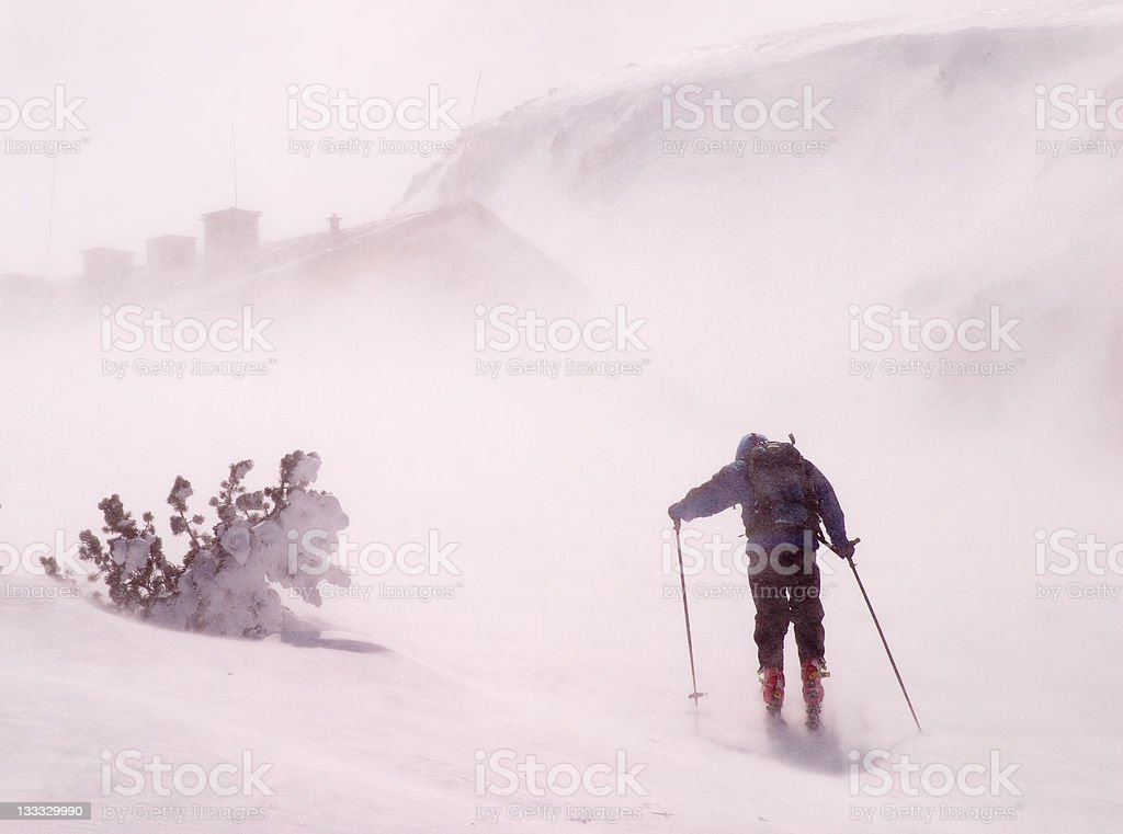 Back country skier walking in a storm royalty-free stock photo