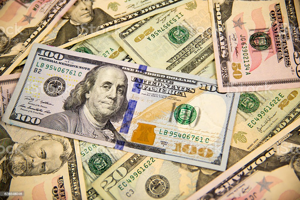 Back ground of various American currency stock photo
