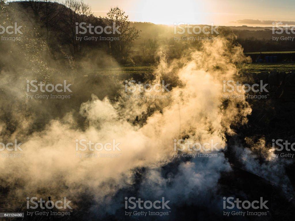 Back lit Bonfire smoke stock photo