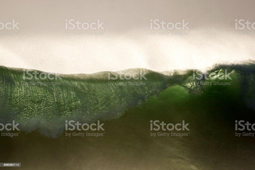 Back lit Ocean Wave stock photo