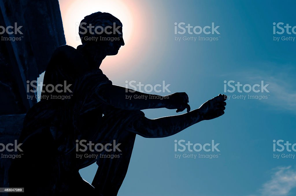 Back lit of god Apollo statue in Pompeii royalty-free stock photo