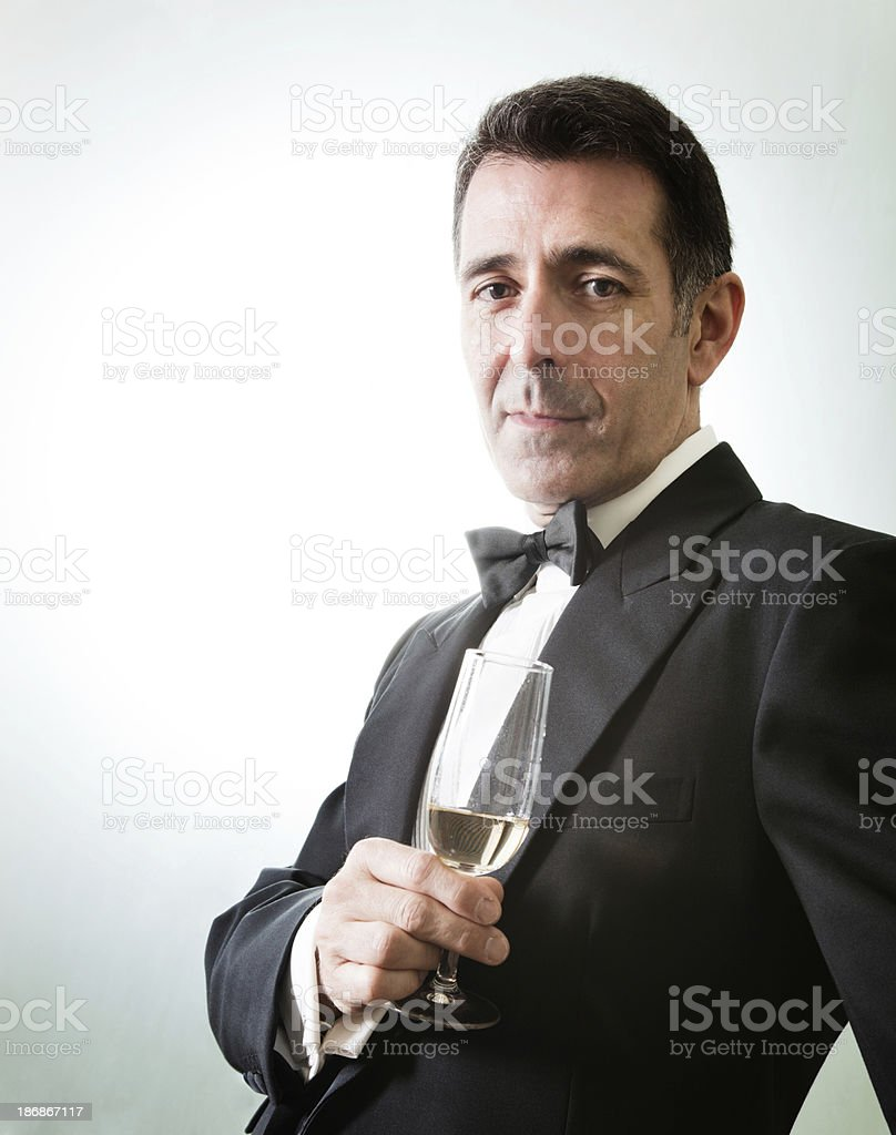 Back lit swank gentleman with champagne royalty-free stock photo