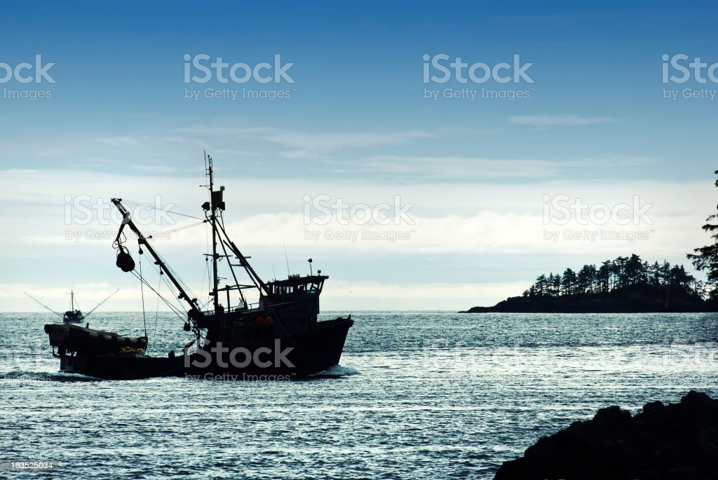 back lit trawler stock photo