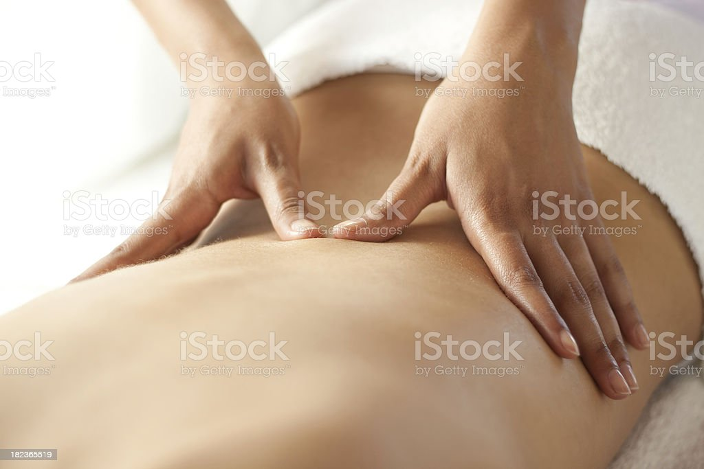Back massage at spa stock photo