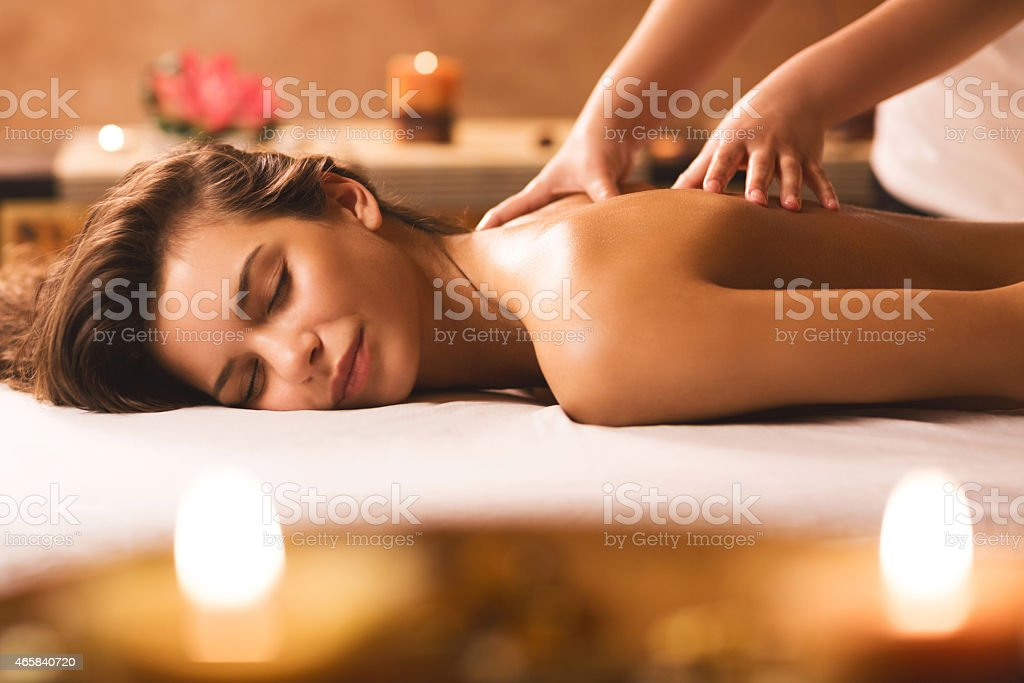 Back massage at the spa. stock photo