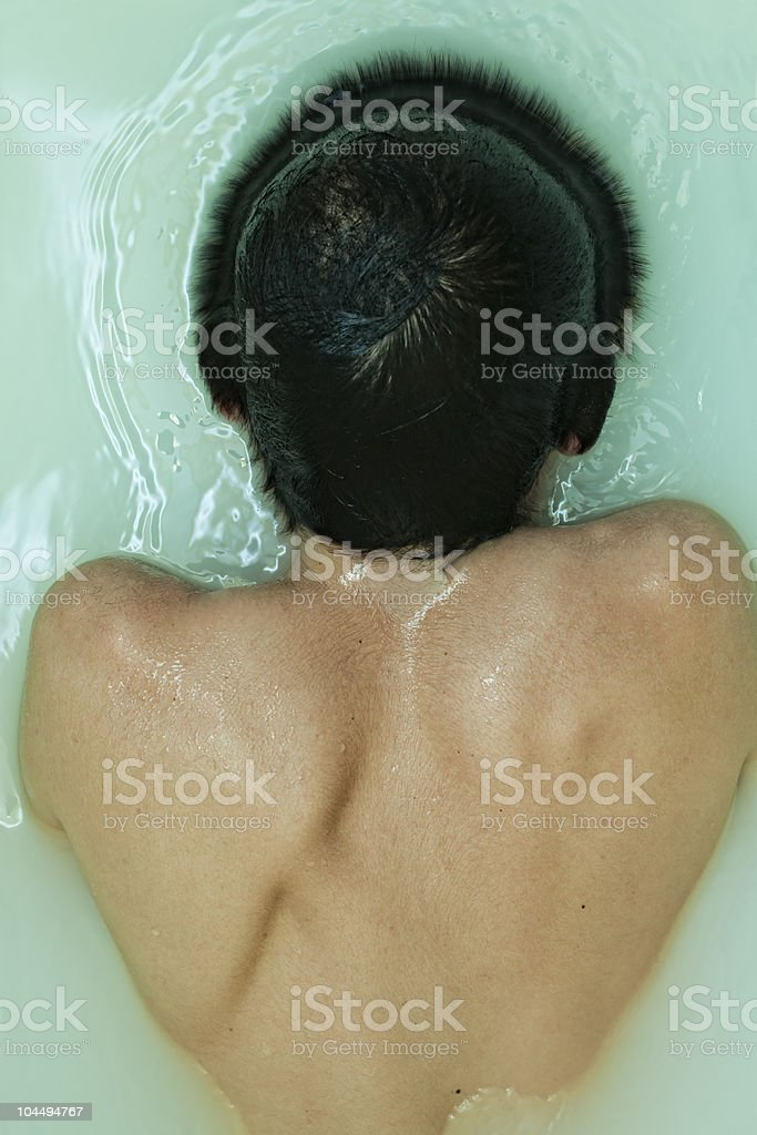 back men in muddy water stock photo