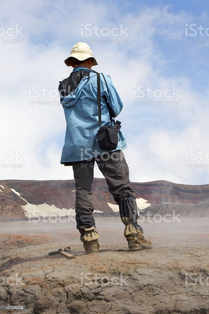 Back of a geologist in a rocky outdoor region stock photo