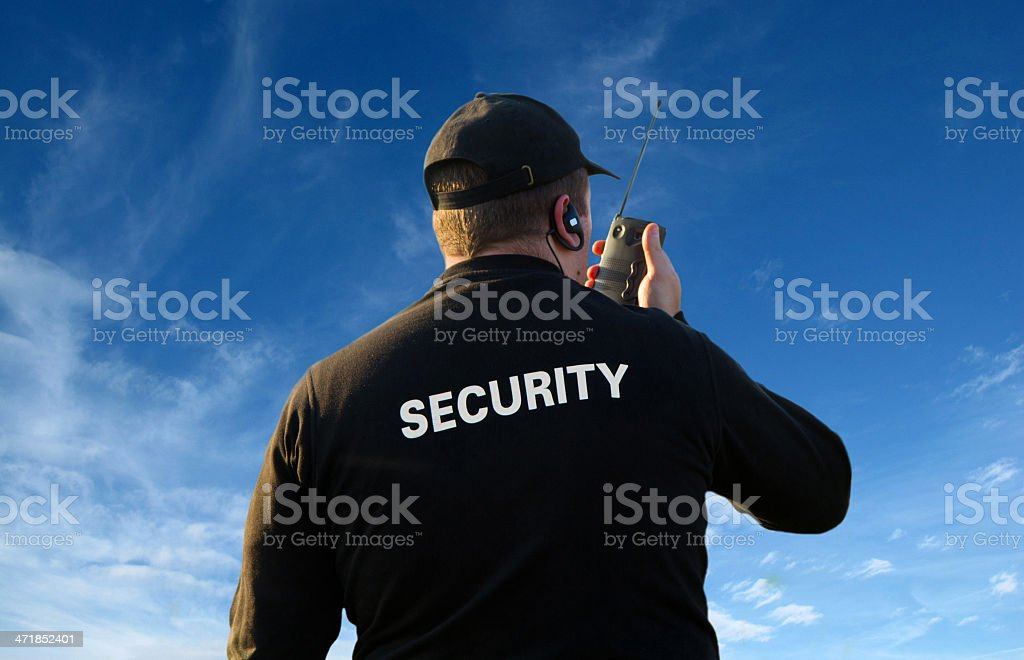back of a security guard stock photo