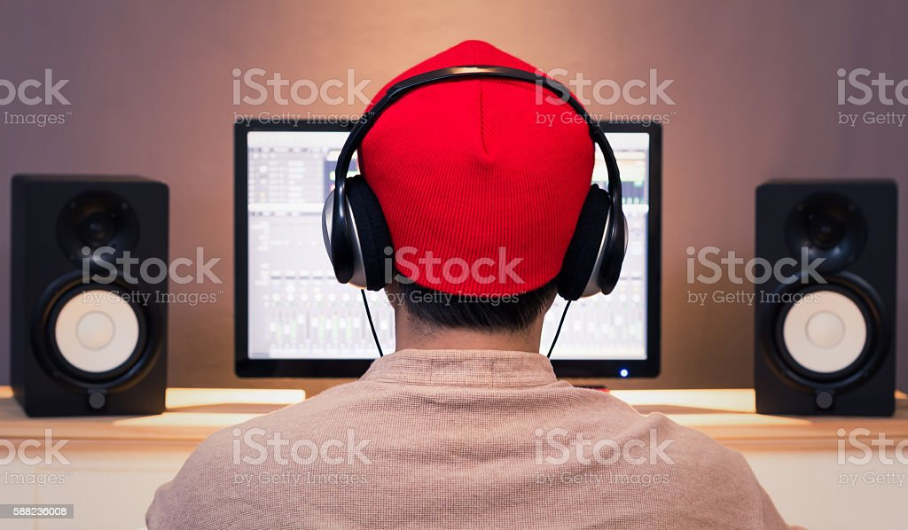 back of asian man listening music with professional audio equipment stock photo