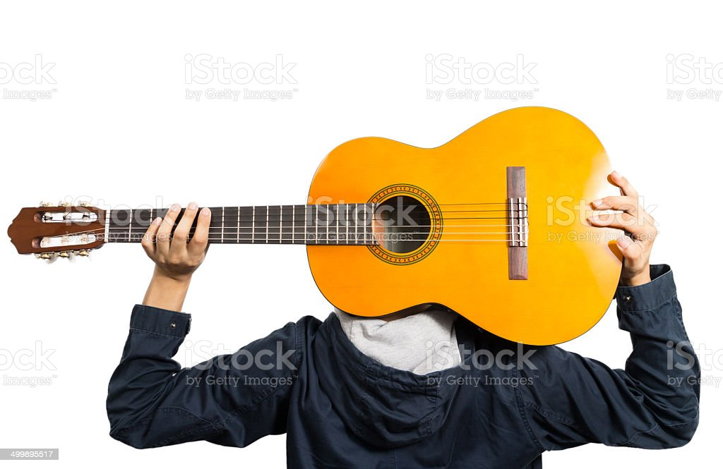 Back of Asian Musician hold his guitar stock photo