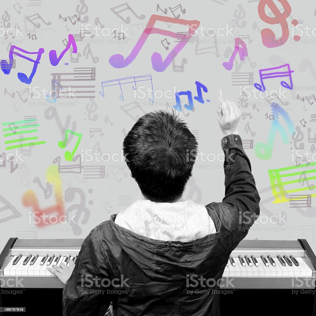 back of asian musician write music note on his imagination stock photo