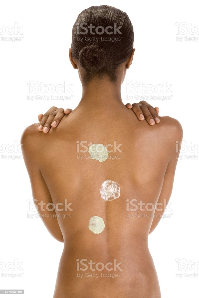 Back of black woman with multicolored cream patch royalty-free stock photo
