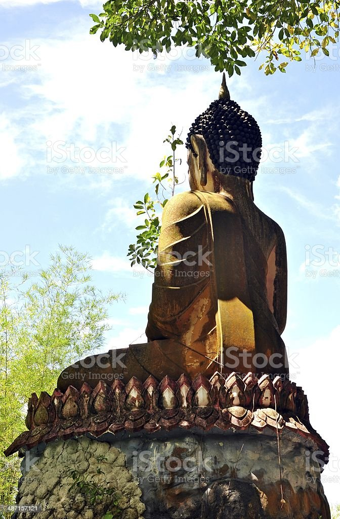 Back of Buddha statue against blue sky royalty-free stock photo