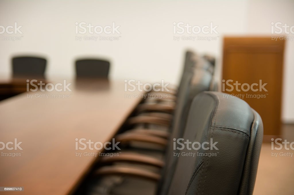 Back of chair around a wooden table stock photo