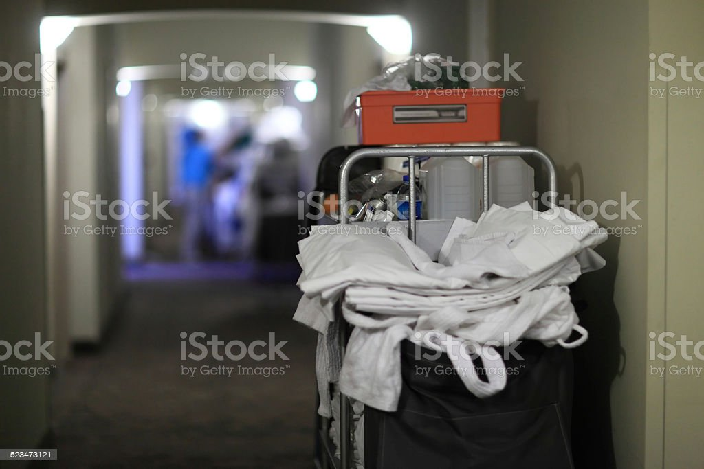 Back of cleaning cart with bedclothes stock photo