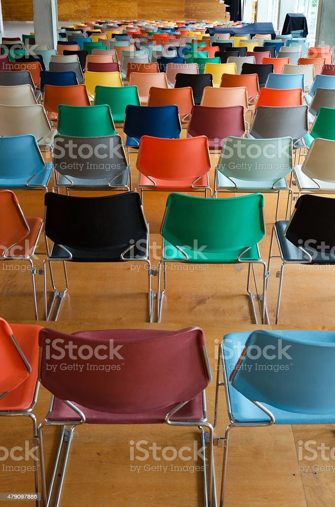 Back of colorful chairs stock photo