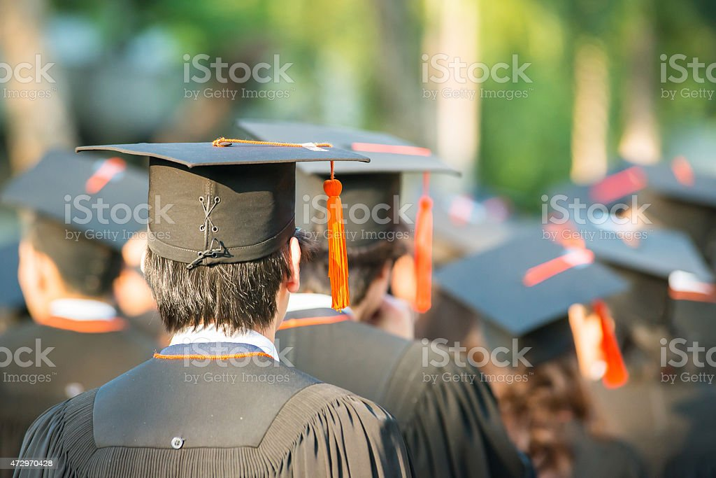 back of graduates during commencement stock photo