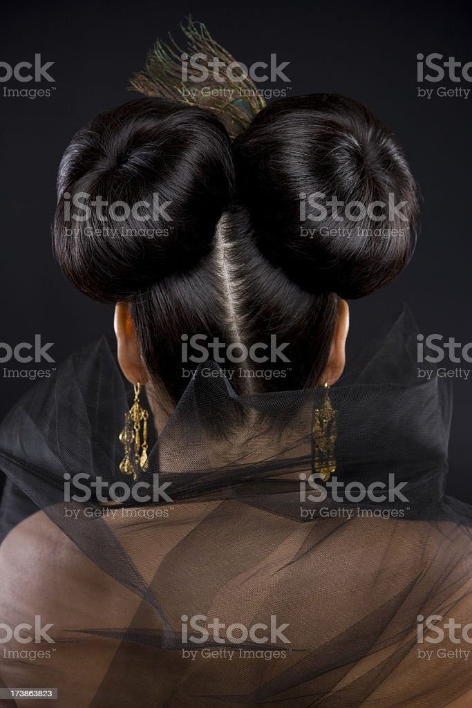 Back of Head with Two Hair Buns, Copy Space royalty-free stock photo
