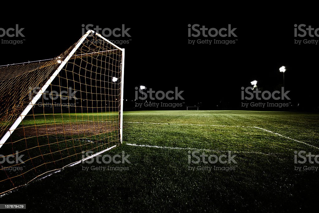Back of soccer net on field in the middle of the night royalty-free stock photo