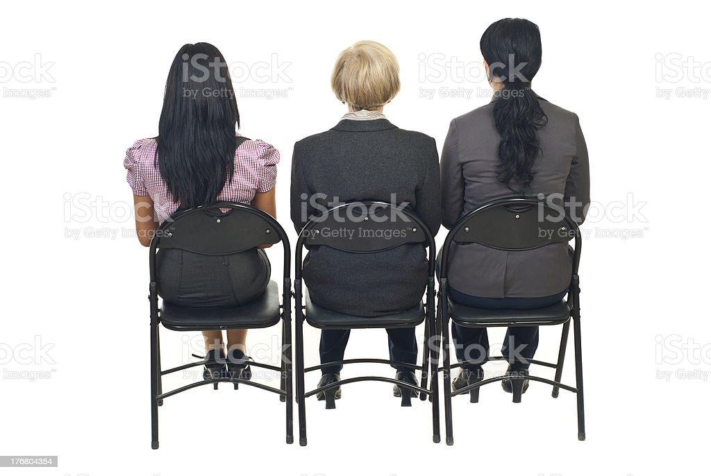 Back of three women at presentation stock photo