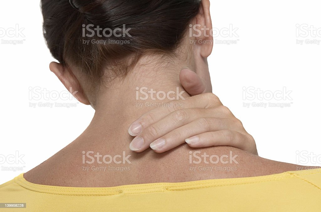 Back of woman with her hand on her neck indicating pain stock photo