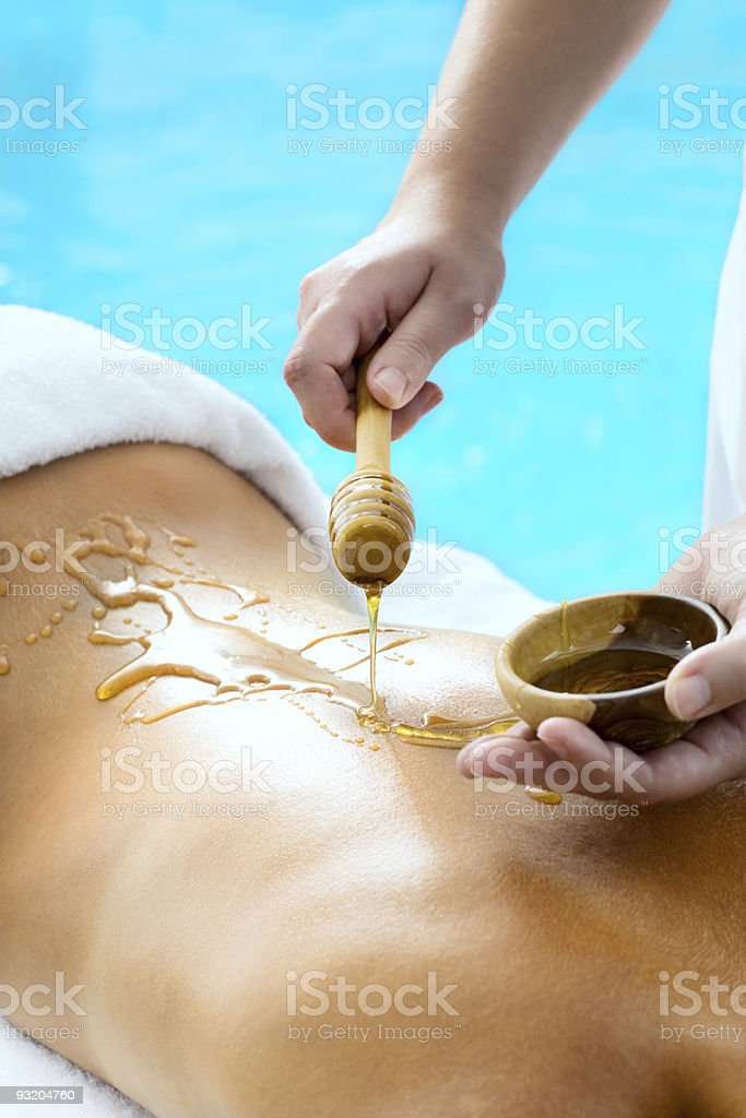 Back of  young woman getting a spa treatment royalty-free stock photo
