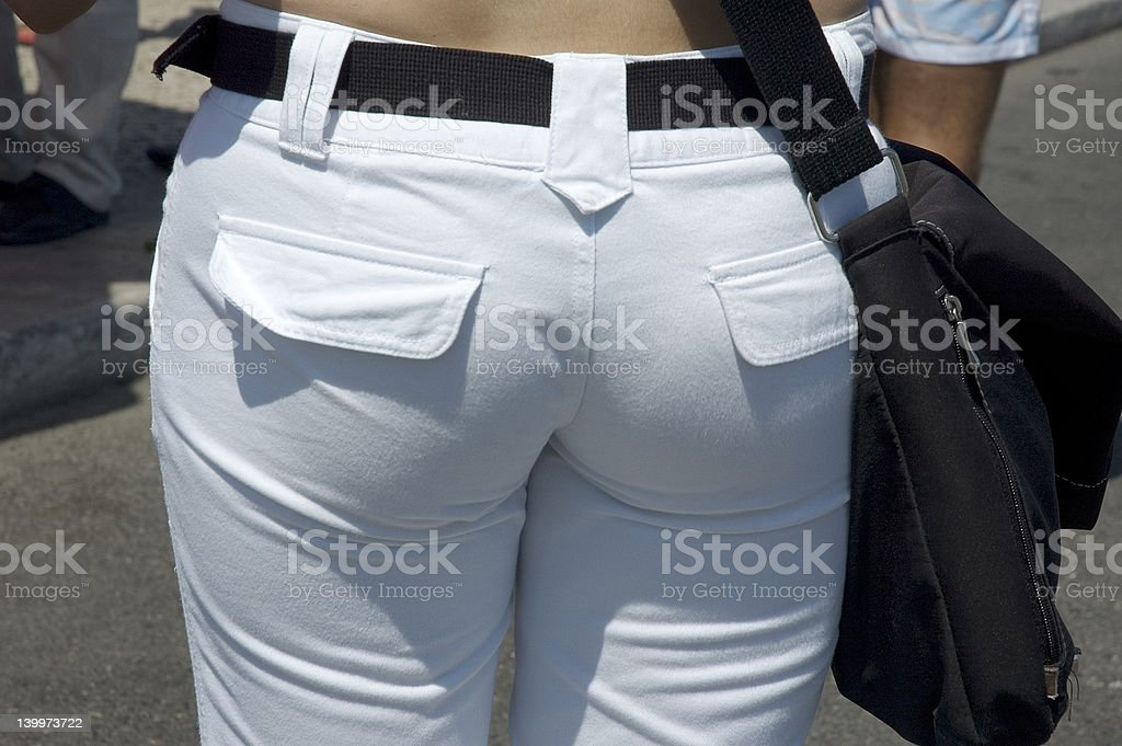 back of young woman in tight jeans stock photo