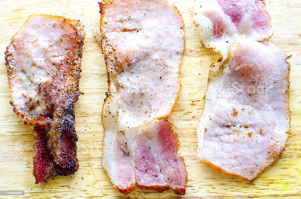 Back  or Canadian bacon deep fried with garlic royalty-free stock photo